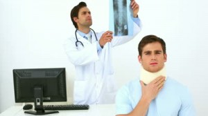 stock-footage-doctor-examining-ray-of-injured-patient-in-neck-brace-in-his-office-at-the-hospital